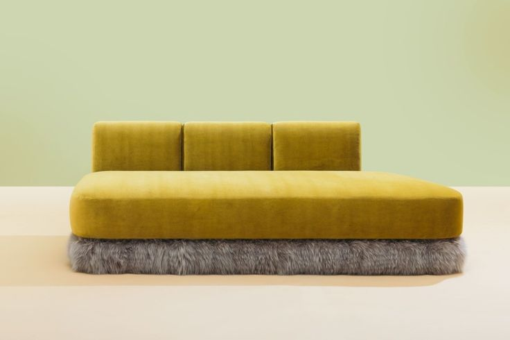 Celestino's sofa for Fendi, sheathed in a Rubelli velvet, is trimmed with fox fur | archdigest.com
