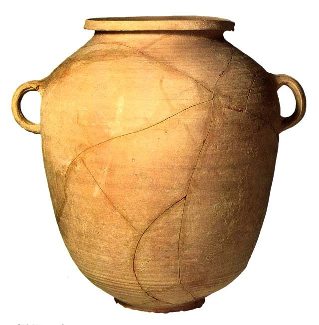 Two-handled Jar, Pottery, First century B.C.E.-first century C.E.,  Height 14 1/2 in., diameter 7 1/4 in. This elongated barrel-shaped jar has a ring base, a ribbed body, a very short wide neck, & two loop handles. The vessel was probably used to store provisions. This object is representative of the finds from the immediate area of Qumran. The repertory of pottery from Qumran chiefly consists of modest utilitarian items including cooking pots, vases & small jugs, serving dishes, drinking…