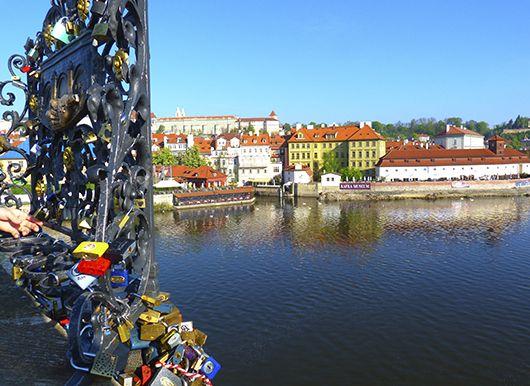 Lovers' padlocks and the view from Charles Bridge, Prague
