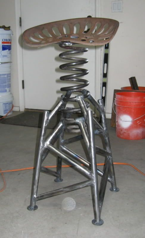 I have to say... the really cool part about owning a welding fabrication shop... Is we can so make this :) Really cool stool.