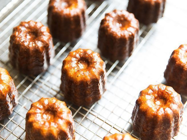 These French pastries are the real deall: crunchy and caramelized to a deep mahogany brown on the outside, moist and custardy within, and deeply perfumed with dark rum and vanilla bean.