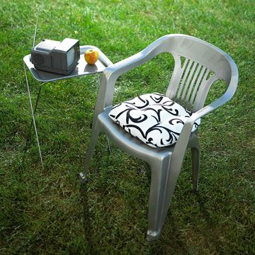 A quick coat of silver spray paint and a boldly colored cushion turn an old plastic chair into a work of art