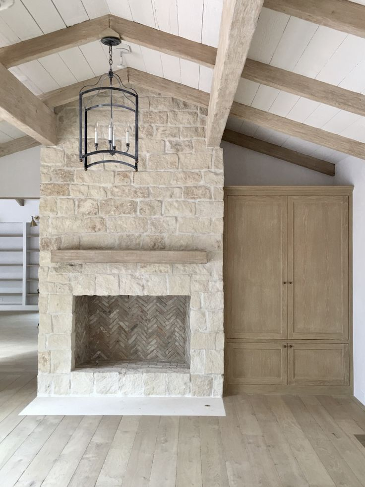 Light Stone French Fireplace | Brooke Giannetti | Velvet & Linen | http://brookegiannetti.typepad.com