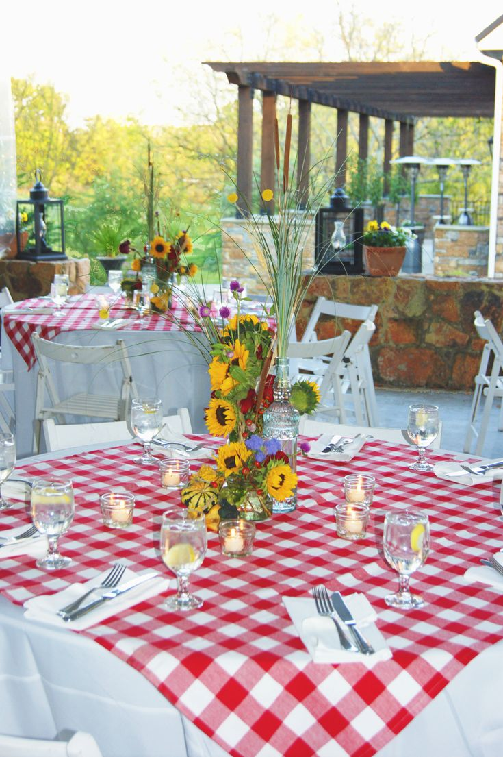 ***Make red/white checkered tablecloth overlays placed over white table cloths; use silk sunflower arrangements in jars with fabric or paper wrapped around & tied with ribbon. Table clothes & centerpiece look perfect! LS. A beautiful Fall BBQ rehearsal dinner.