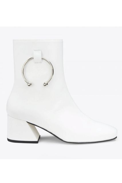 Do your best Twiggy.Dorateymur Nizip Boots in White Napa Leather, $495, available at Dorateymur.  #refinery29 http://www.refinery29.com/leather-boots-for-women#slide-12