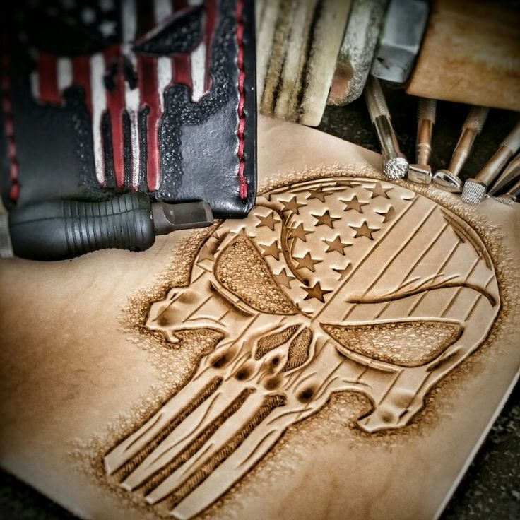 Tooled leather stars and stripes punisher! Follow us on Instagram @leatherandstitches