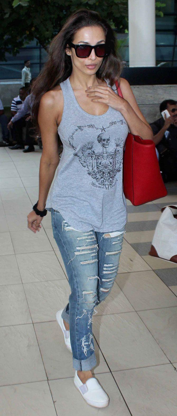 Malaika Arora Khan at Mumbai airport. #Bollywood #Fashion #Style #Beauty #Hot #Sexy #WAGS