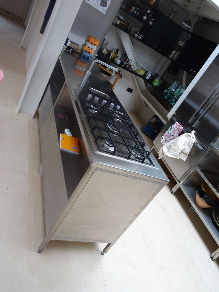 Stainless steel worktop with hob, hot water tap and small sink basin