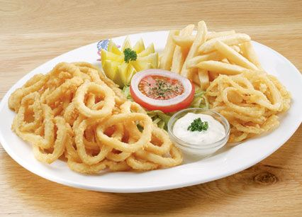 Calamari. Lightly dusted, flash-fried calamari rings, served with tartare sauce at Spur Steak Ranches | http://www.spur.co.za/menu/chicken-schnitzel-seafood