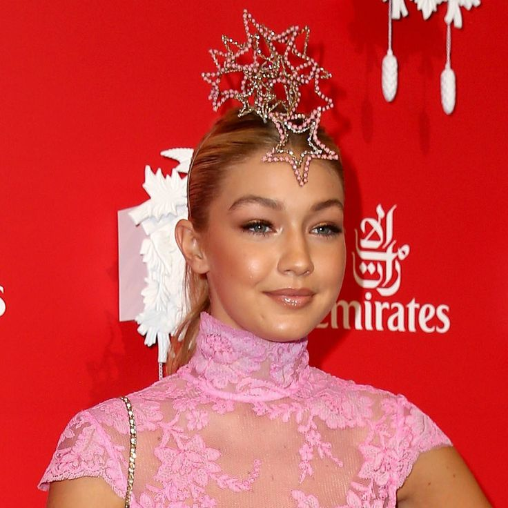 Gigi Hadid: Prep hair with Miracle Hair Treatment and blow dry in. Sweep back into tight ponytail with a slight centre part. Finish with Give Me Hold Flexible Hairspray.  #GigiHadid #MiracleHairTreatment #GiveMeHoldFlexibleHairspray #ELEVENAustralia #MelbourneCup