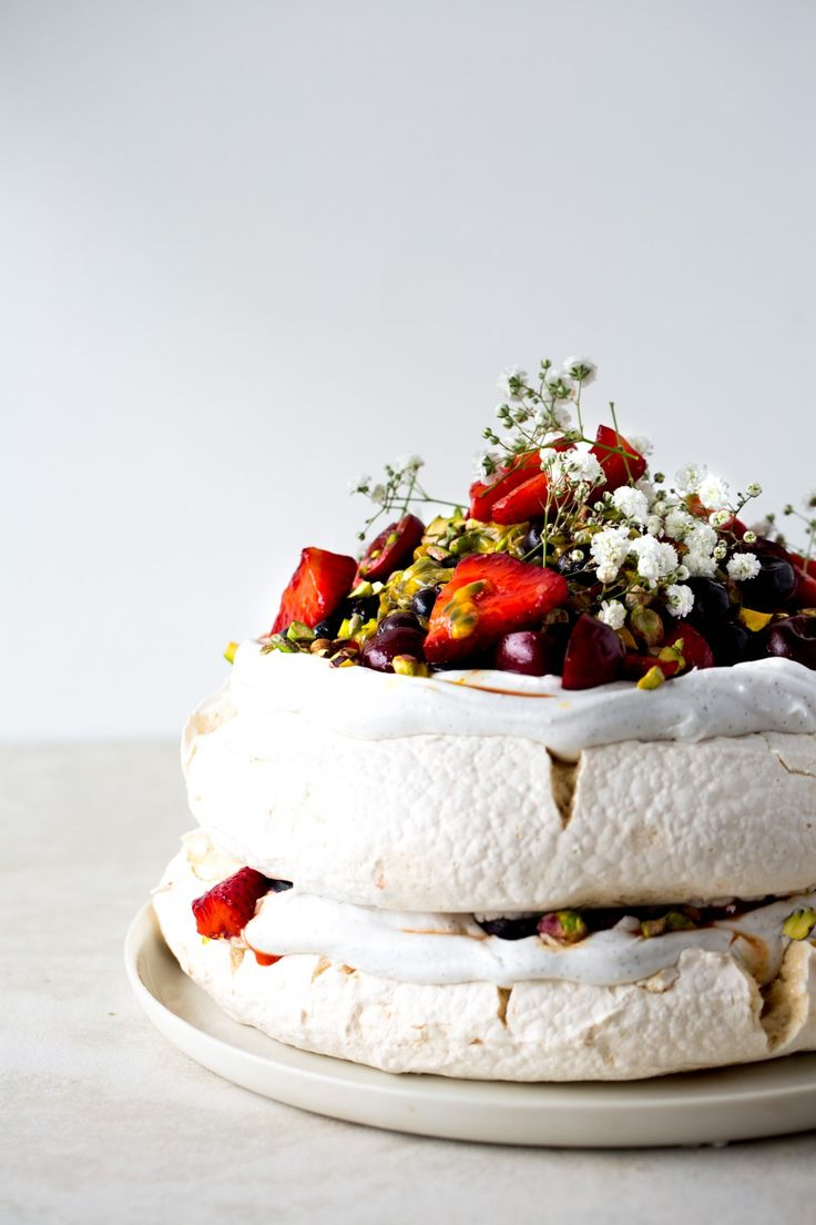 Pavlova with berries, passion fruit and pistachio