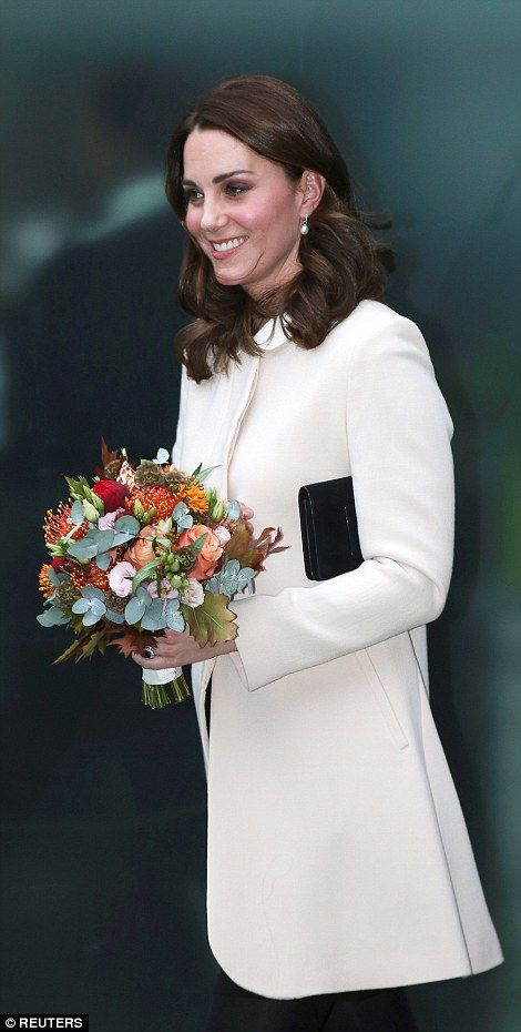 The Duchess was presented with a beautiful bouquet of flowers as she left the centre