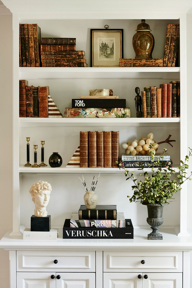 katherine power lists her beverly hills home for sale take the tour this styled bookshelf features a mix of antique books striped bookends vases