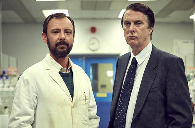 John Simm and David Threlfall in the fact-based mystery CODE OF A KILLER, which traces the first use of DNA fingerprinting to catch a murderer.
