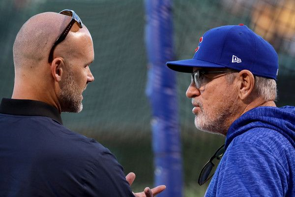 Joe Maddon Photos - Former Chicago Cubs player David Ross meets with manager Joe Maddon of the Chicago Cubs before game four of the National League Championship Series against the Los Angeles Dodgers at Wrigley Field on October 18, 2017 in Chicago, Illinois. - League Championship Series - Los Angeles Dodgers v Chicago Cubs - Game Four