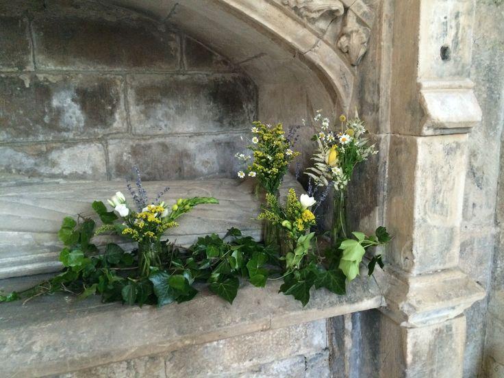 Simple flowers warming the old stones. Seton Collegiate Church