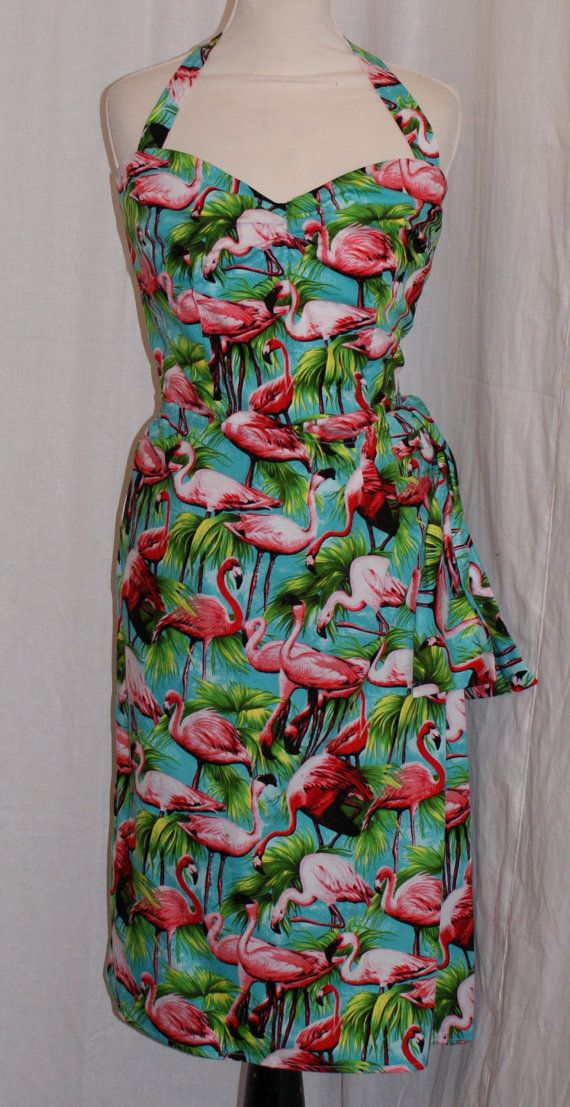 I've been looking for a flamingo print dress for about 4 weeks now. I love this one and this shop. This lady makes some killer 50's hawaiin dresses.