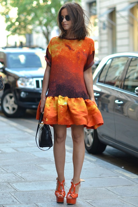 Orange looks chic here, but with the addition of the black, it doesn't look too bright.