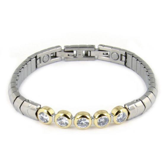 A flexible tennis bracelet with five mounted cubic zirkonia stones - super chic. http://www.byariane.com.au/Energetix-Two-Tone-Bracelet