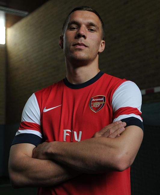 HI POD ... Lukas Podolski models Arsenal's new shirt for the first time