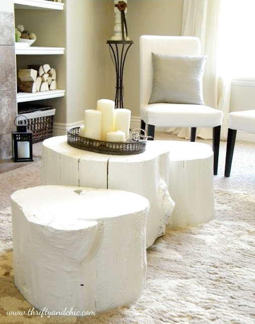 Love the idea of painting large stumps for a coffee table and footstools.
