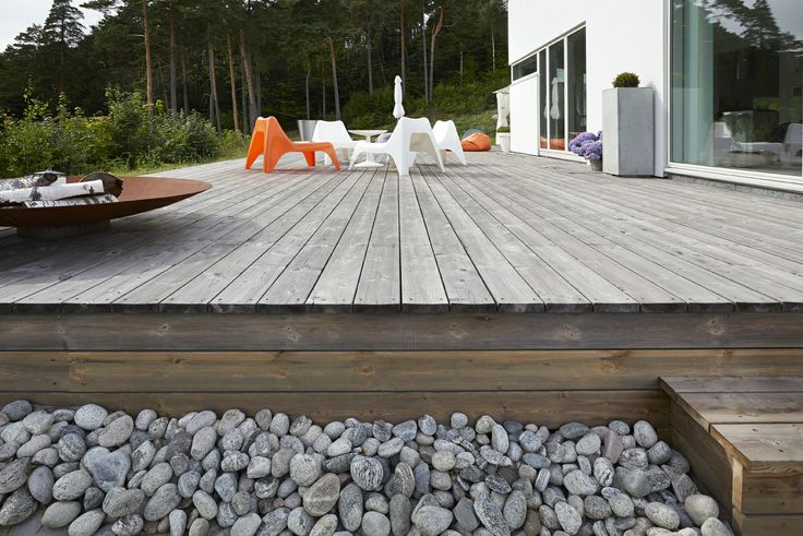 This private terrace in Norway in weathered Kebony Scots Pine is one of our favorites this spring . All Kebony woods acquire a silver patina after exposure to the elements. Performance maintained and beauty enhanced!