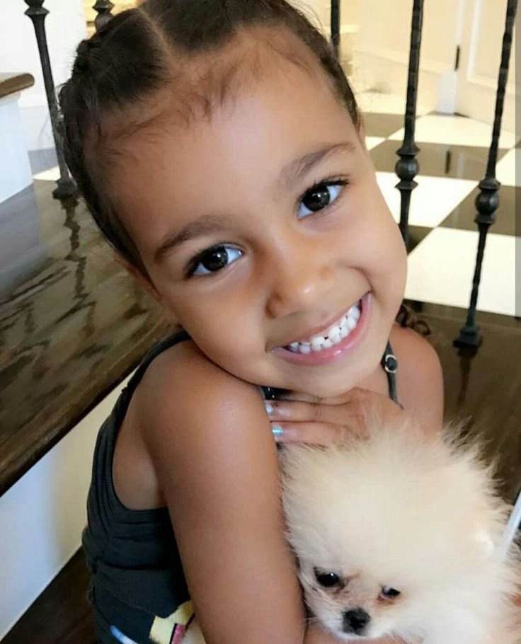 NORTH WEST WITH HER NEW PUPPY SHE JUST GOT ON HER 4TH BIRTHDAY FROM MOMMY