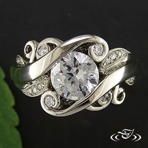 A romantic ring to get caught up in! Vine swirls and spring leaves frame a lovely center stone.
