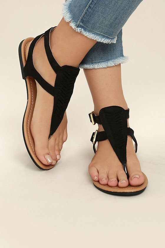 Festival bound? Be sure to pack the Draya Black Suede Flat Sandals! These lightweight, vegan suede sandals have a toe thong upper, and braided T-strap, with two adjustable gold buckles at the outstep.