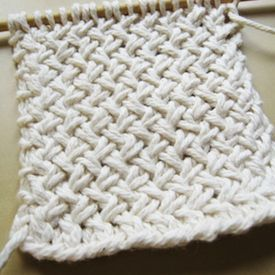 Learn to knit this great textured pattern   with the help of a photo tutorial. Perfect for cozy blankets!