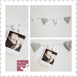 White and gray hearts made of felt, together they are a picture or card-hanger. All hearts are silver colored pegs. And the choir is colored silver. The white left heart is smaller than the other three. #Babylove #Babyroom #Babydecor