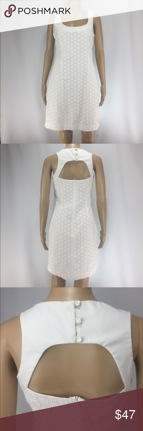 """TRINA TURK Dress! TRINA TURK Dress! Beautiful all white cotton dress. Size 6. Measurements are approximately: total length 34"""", chest 34"""", waist 32"""", hips 36"""". Fully lined. Features front darts, cut out back, and a 13"""" hidden zipper. Excellent used condition. See pics! Trina Turk Dresses Midi"""