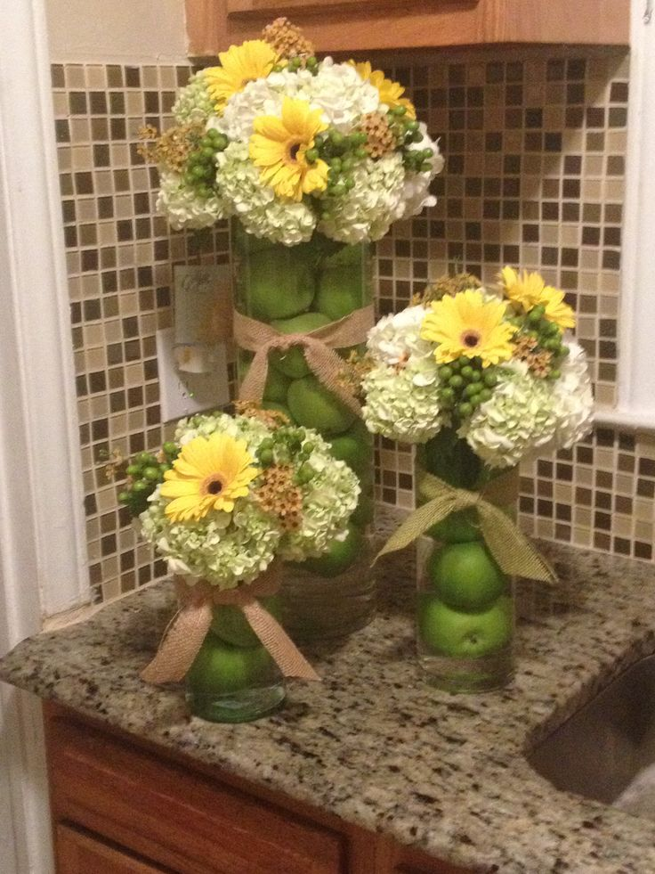 Neutral green white and yellow fall baby shower arrangements