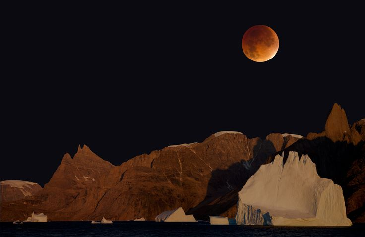 Bear Island with blood moon. - Composite image of Bear Island and blood moon.