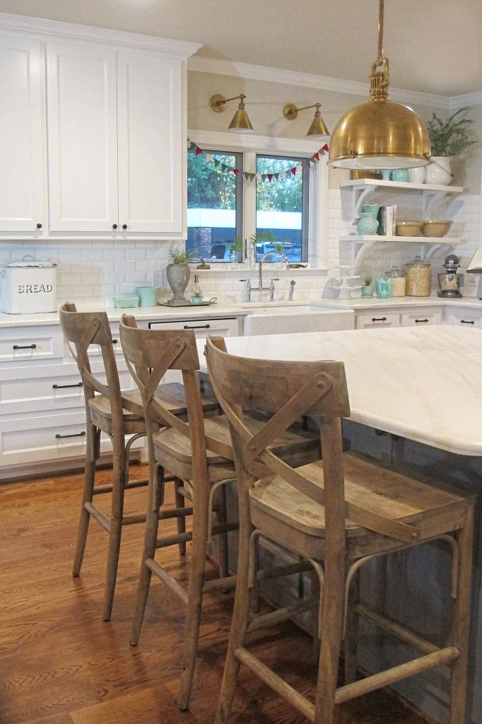 the stools are from World Market, the chandelier is vintage and original to  the home and of course the
