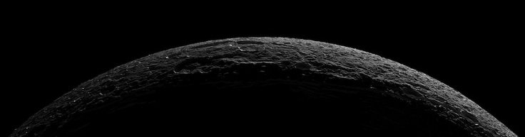 Dione Crescent As it departed its encounter with Saturn's moon Dione, Cassini sailed above an unreal landscape blasted by impacts. The rising Sun throws craters into sharp contrast and reveals steep crater walls.  At the far right, a medium-sized crater is bisected by a fracture, revealing a cross section of the impact site.  The seven clear-filter images in this mosaic were taken with the Cassini spacecraft narrow-angle camera on Oct. 11, 2005, at distances ranging from of 21,650 to 25,580…