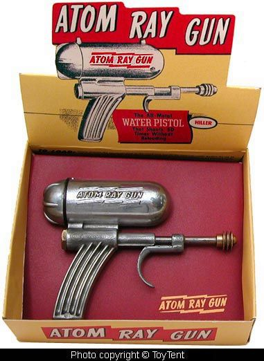 by toytent ray gun space toy. When we played with guns, we were not callously shooting down people in our own reality. We were heros, shooting bad guys in the Old West, or futuristic evil alien monsters from space!