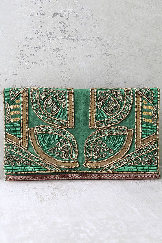 """Elegant in every way, the Bead the Best Green Velvet Beaded Clutch will be your fave special occasion accessory! Soft velvet clutch decorated with green and bronze beads and sequins, plus pink embroidered trim. Lift front flap from the magnetic closure to find a roomy interior with side wall pocket. Carry as a clutch, or use the attached 40"""" gold chain strap."""
