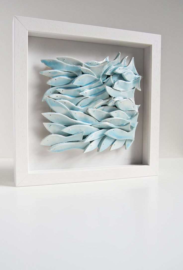 wall tile, School of Fish, sculptural ceramic artwork , white, light blue, nautical wall decor, seaside home decor, wall hanging. via Etsy.  Could be translated to paper