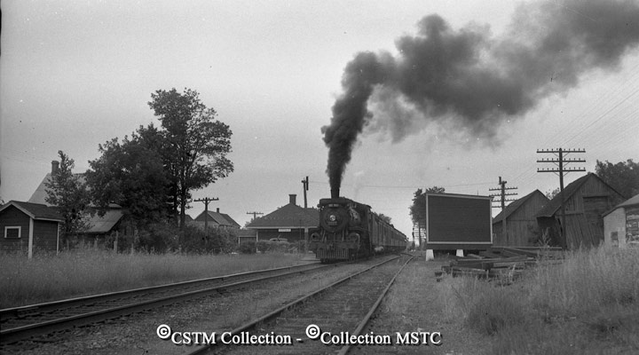 """Location: Stittsville, ON  Railway Name: CANADIAN PACIFIC RAILWAY CO.  Date: 1947-00-00  Caption: """"Pembroke local train, summer."""""""