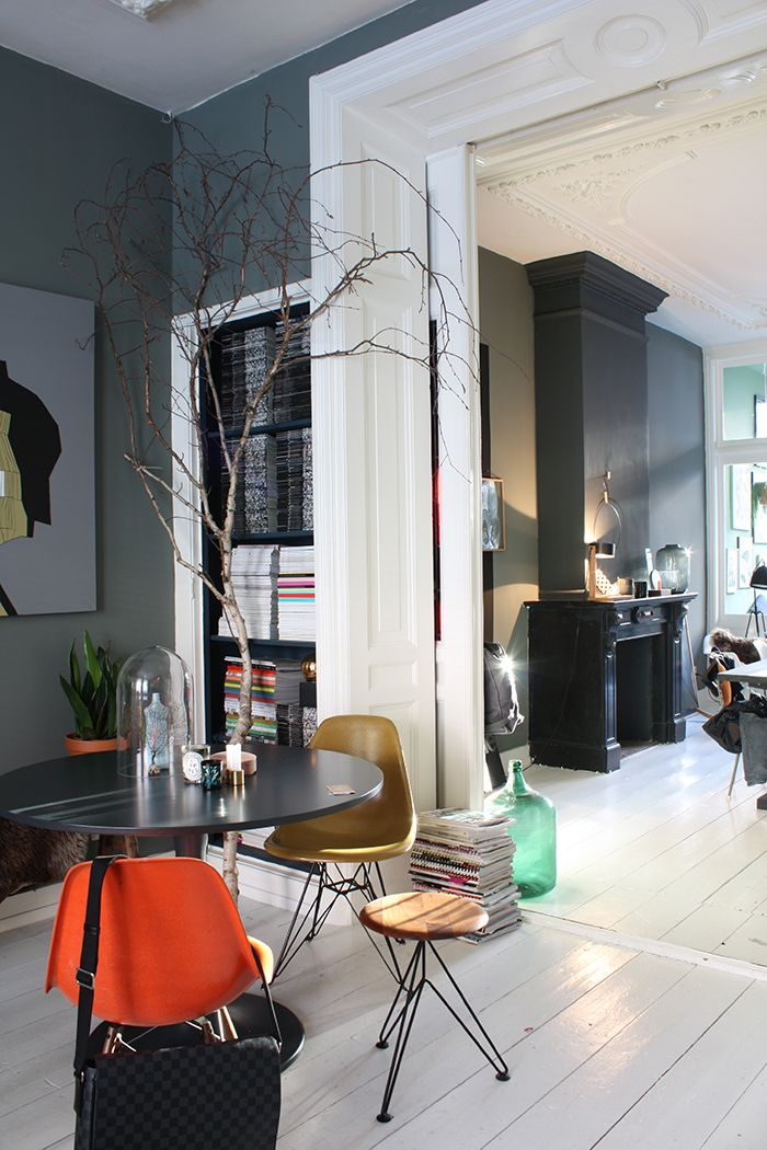 Built-in magazine storage. Dark colours in a Dutch Home