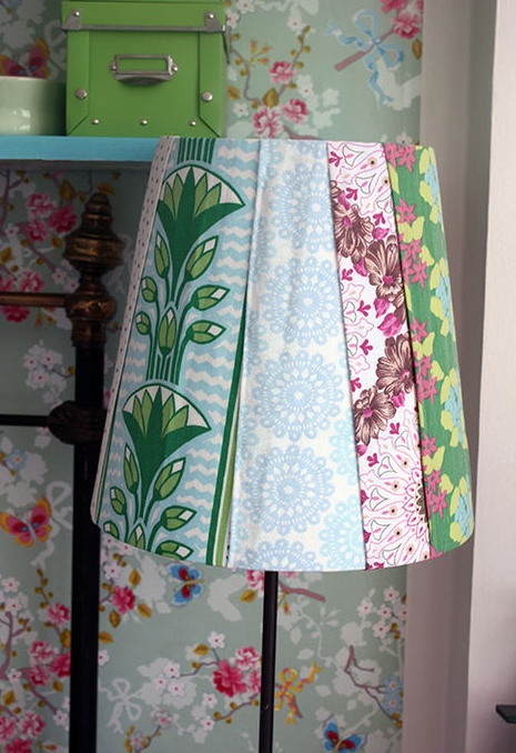 Make over of an old lampshade, with vintage fabric pieces overlapping and glued on to the back of the shade...