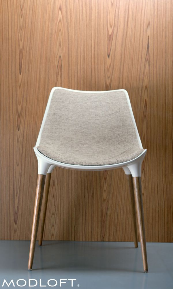 The beautiful Langham dining chair by Modloft is made with steel core legs finished in Brazilian walnut veneer, a bucket seat made of fiberglass finished in white gloss, and upholstered in an oatmeal linen blend making it (in our opinion) our favorite chair. Available in our quick-ship program for immediate delivery.