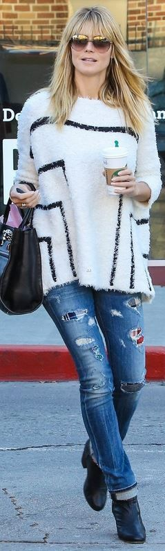 Who made  Heidi Klum's blue ripped jeans, white stripe sweater, black handbag, and ankle boots?