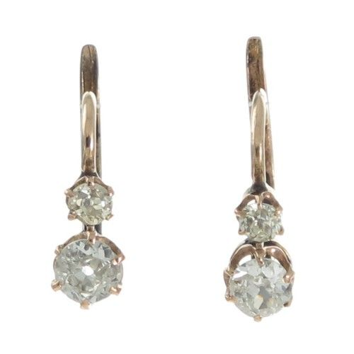 A pair of antique 18ct rose gold earrings each featuring an old cut diamond the pair totaling approximately 0.68ct each set in six claws that sweep down to a scalloped gallery both surmounted by a slightly smaller old cut diamond also in six claws and each pair is fitted to the front of European hook style fittings. #Rutherford #Melbourne