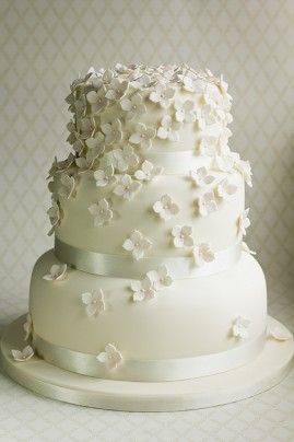 hydrangea petal wedding cake, this would be so pretty with red flowers :)