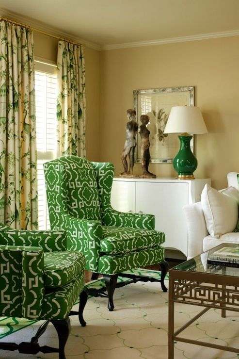 Inverness - Tobi Fairley Interior Design Green & Gold Living Room - drapes  over shutters, wingback chairs in green pattern fabric - 100+ Ideas To Try About Olive & Oak Green Decor Green Wall Color