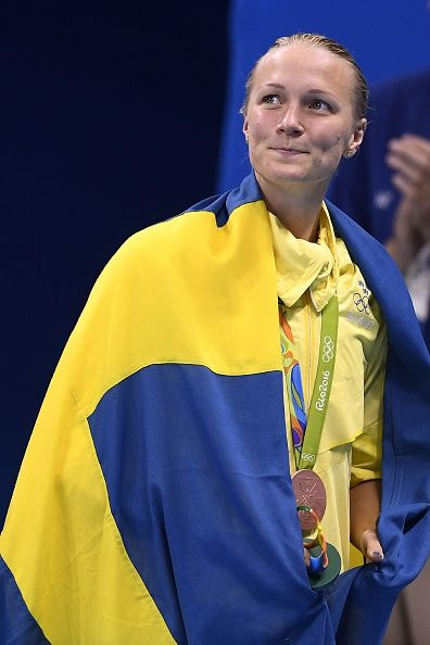 #RIO2016 Bronze medallist Sweden's Sarah Sjostrom smiles while wrapped in her national flag during the medal ceremony of the Women's 100m Freestyle Final...
