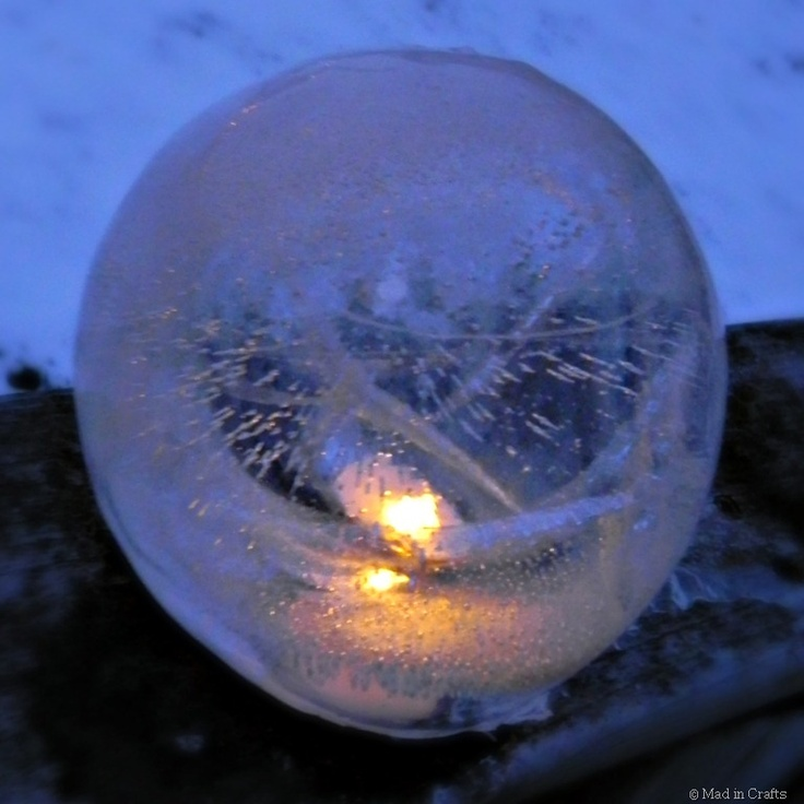 Ice Globe Lanterns - Made from freezing water in a balloon.