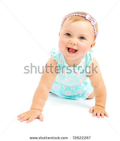 Adorable little baby girl laughing creeping playing in the studio isolated on white